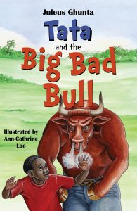 Book cover with big red bull and little boy.